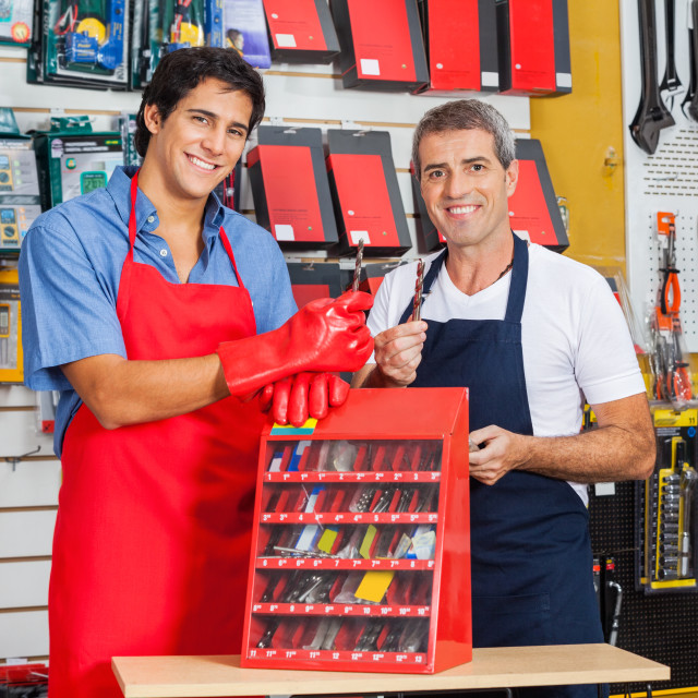 """Salesmen Showing Drill Bits In Shop"" stock image"