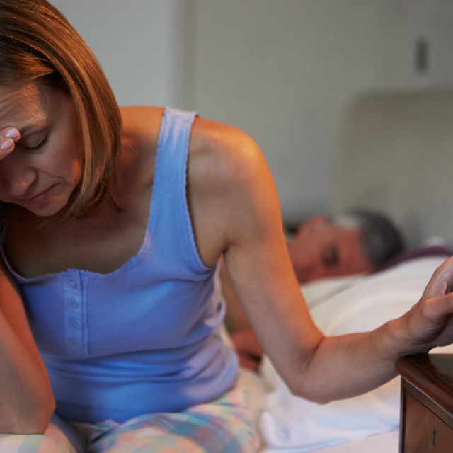 """Woman Awake In Bed Suffering With Insomnia"" stock image"