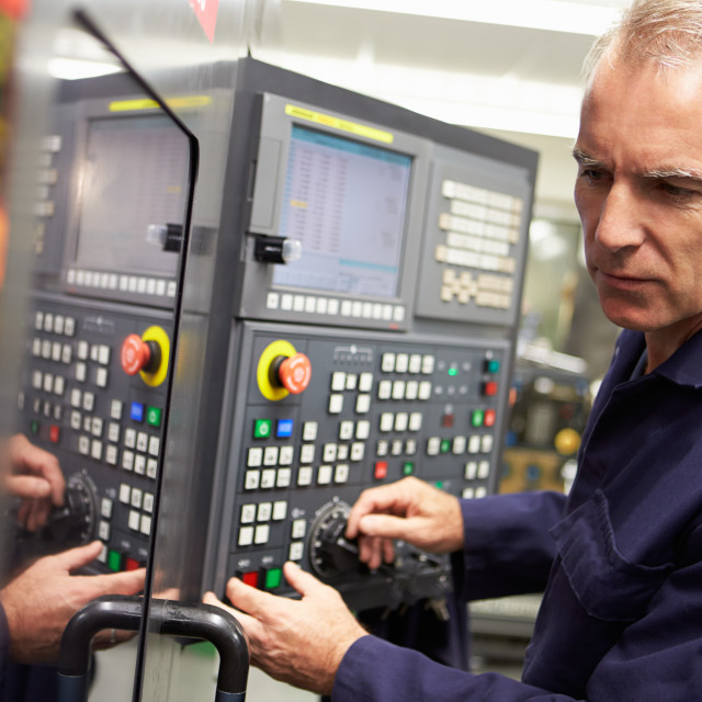 """Engineer Operating Computer Controlled Lathe"" stock image"