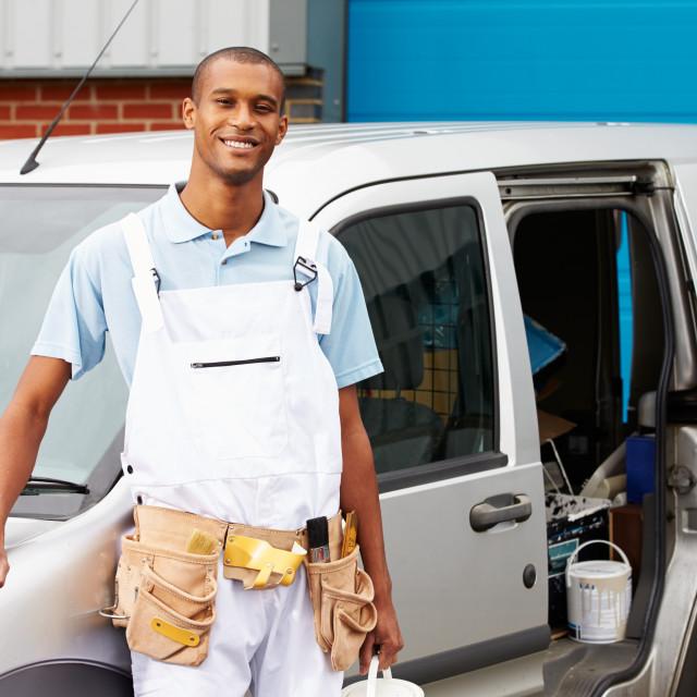 """""""Decorator Wearing Overalls Standing Next To Van"""" stock image"""