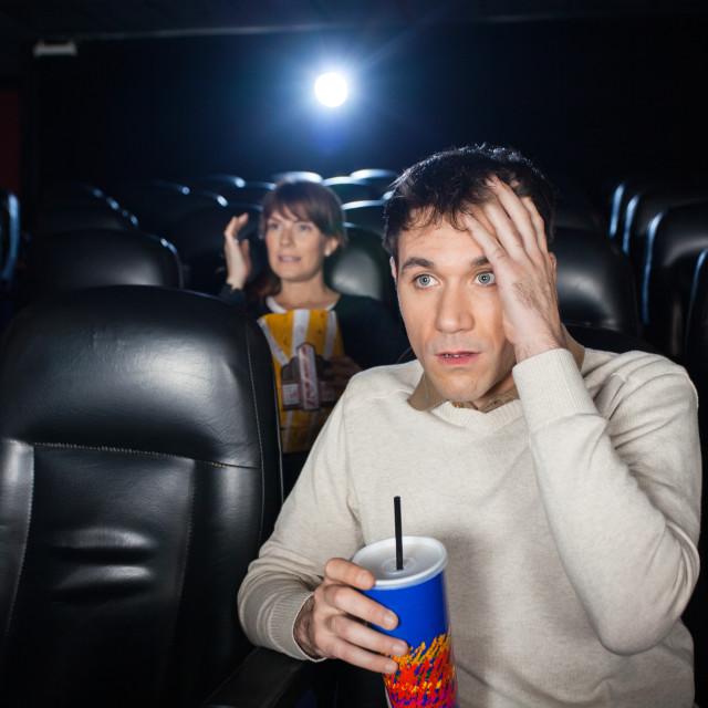 """Terrified People Watching Film"" stock image"