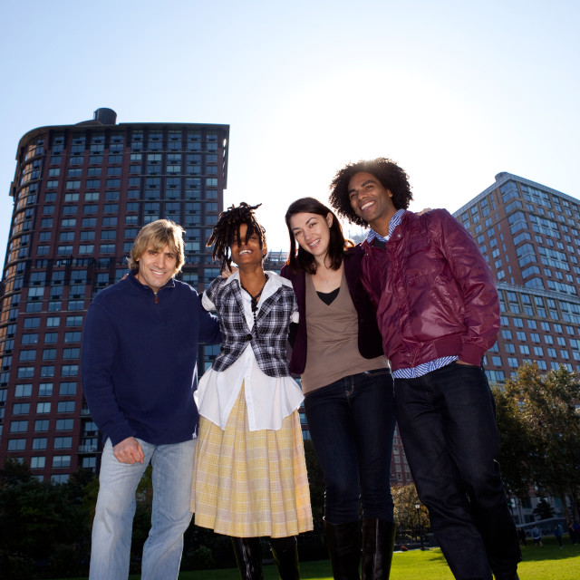 """Four People in Urban Park"" stock image"