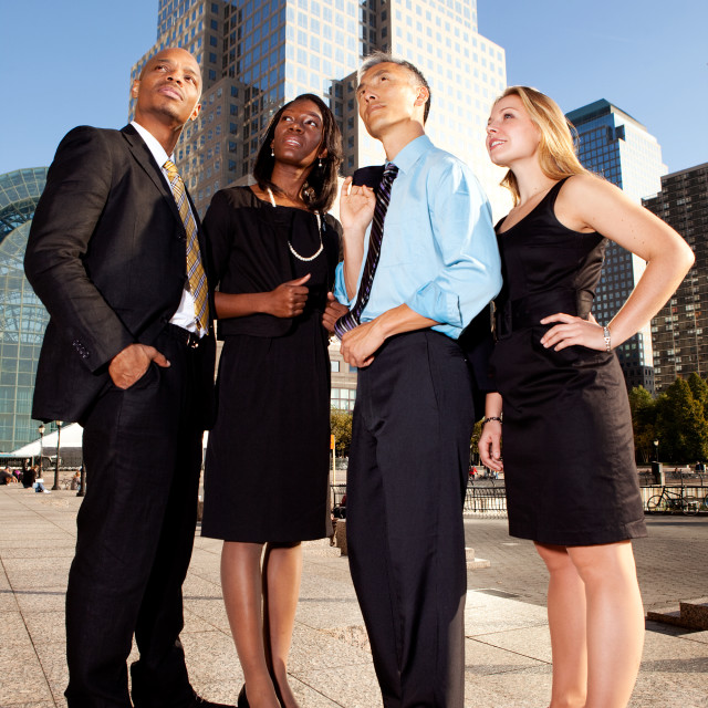 """Four Business People Looking Upwards"" stock image"