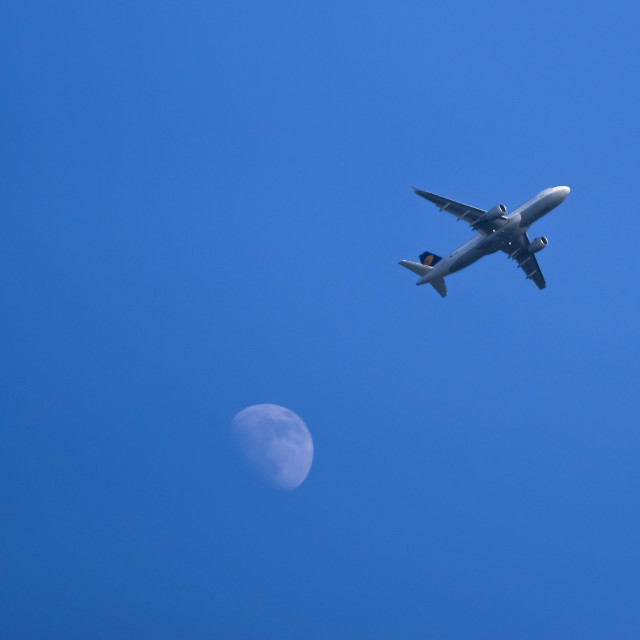 """Plane and the moon."" stock image"