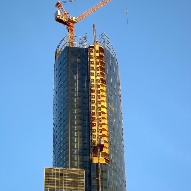 """Crane on Skyscraper"" stock image"