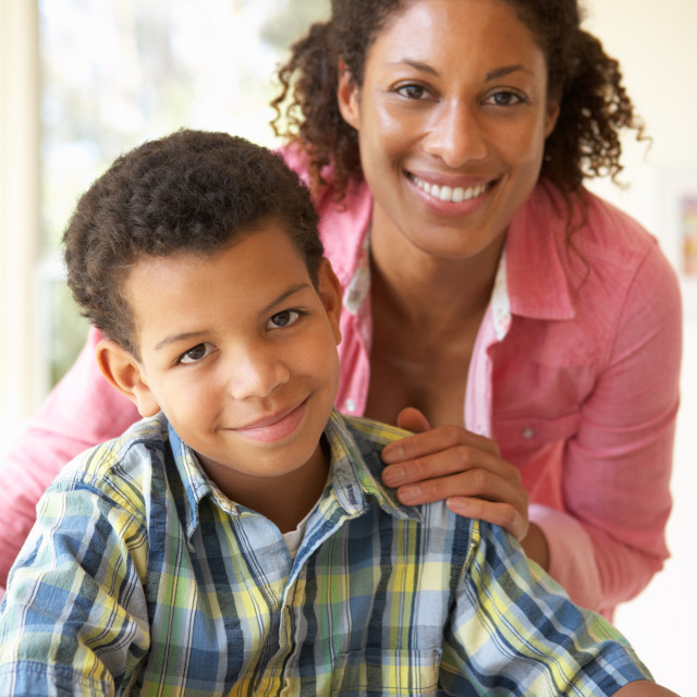 """Mother Helping Son With Homework At Home"" stock image"