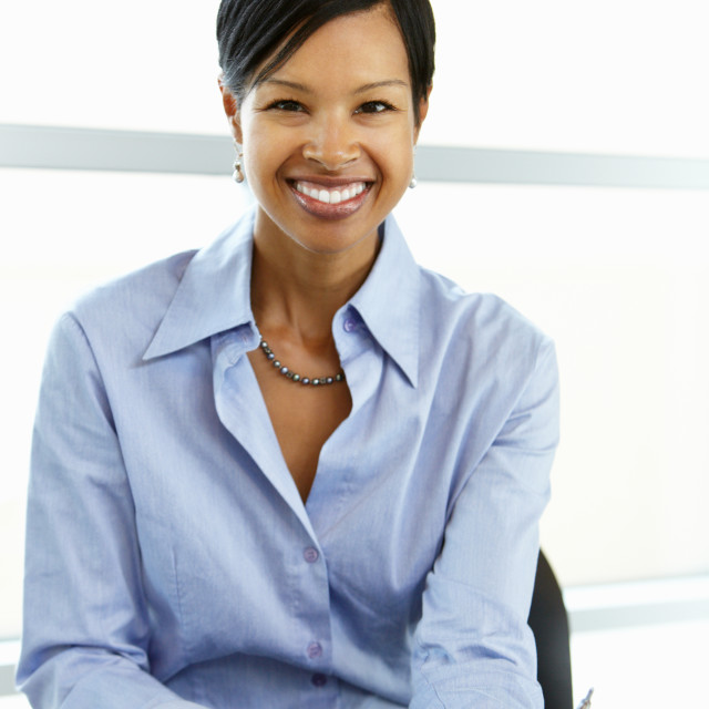 """""""African American woman working at desk"""" stock image"""