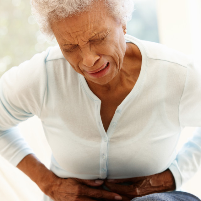 """""""Senior woman with stomach ache"""" stock image"""