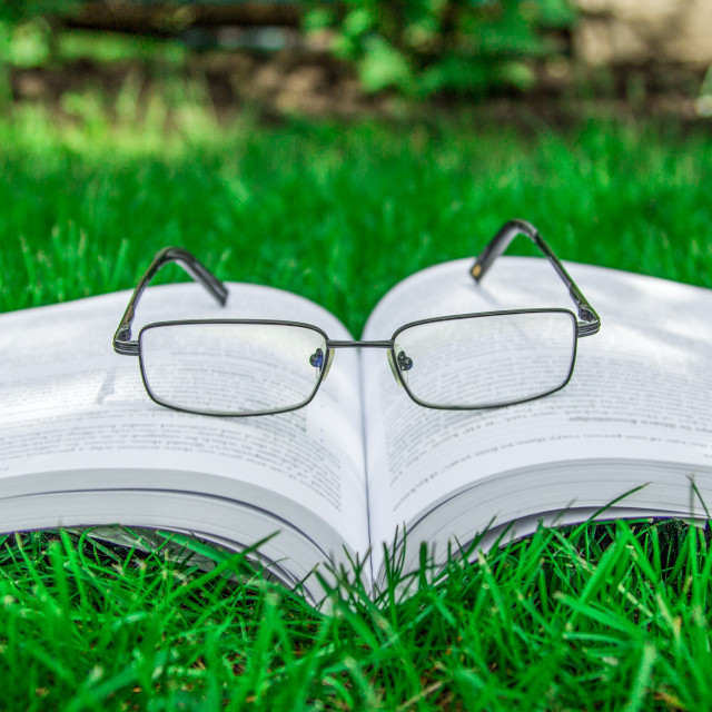 """Opened paper book with glasses"" stock image"
