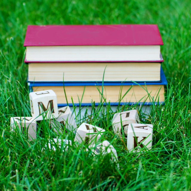 """""""Stack of books with wooden letter boxes"""" stock image"""