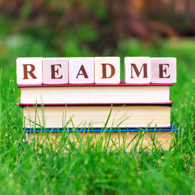 """""""Stack of the books with """"Read me"""" sign"""" stock image"""
