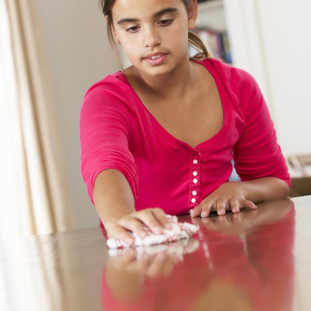 """""""Girl Polishing Table At Home"""" stock image"""