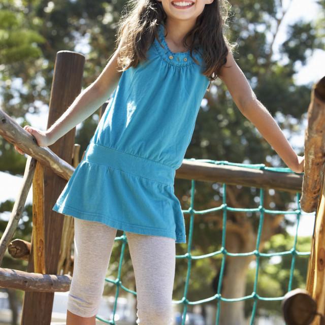 """Young Girl Having Fun On Climbing Frame"" stock image"