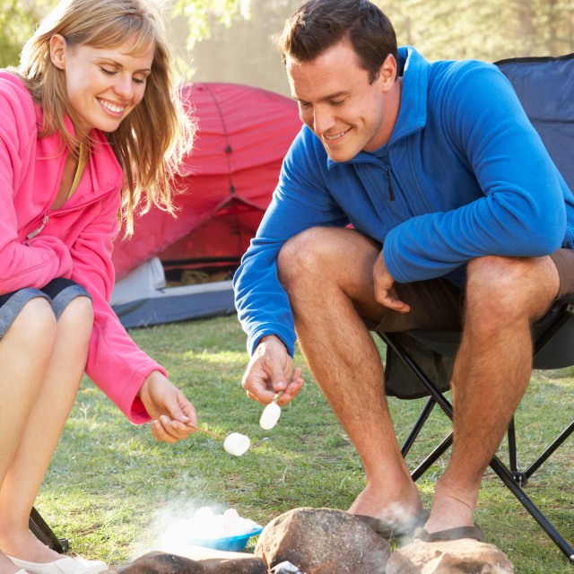 """""""Couple Toasting Marshmallows Over Fire Camping Holiday"""" stock image"""