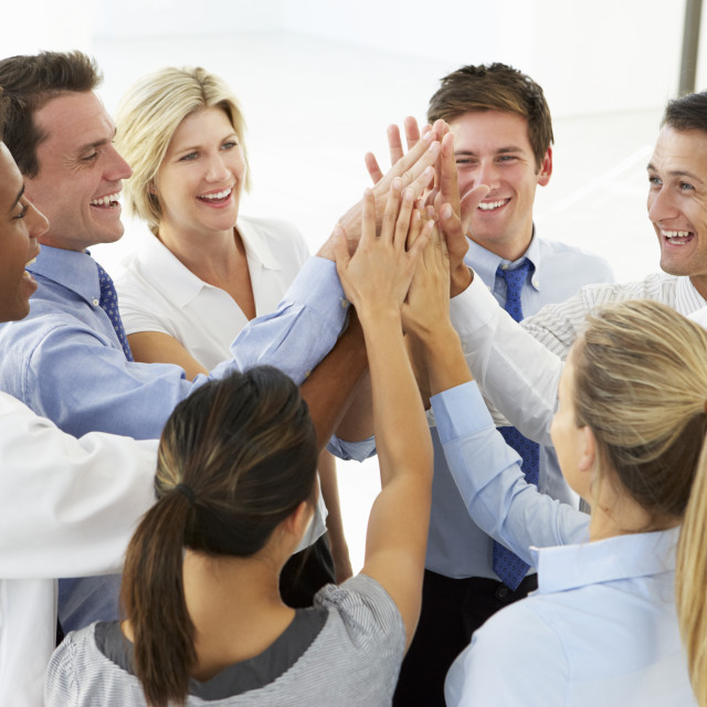 """""""Close Up Of Business People Joining Hands In Team Building Exercise"""" stock image"""