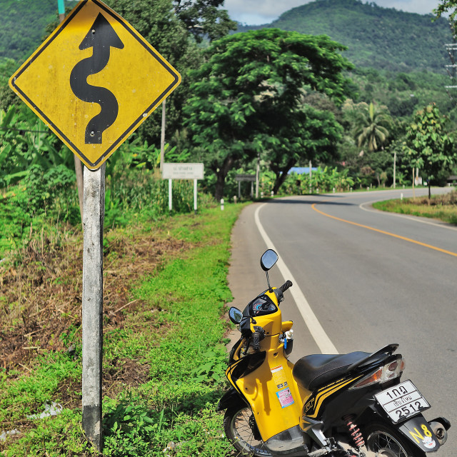 """Motorcycle and Sign"" stock image"