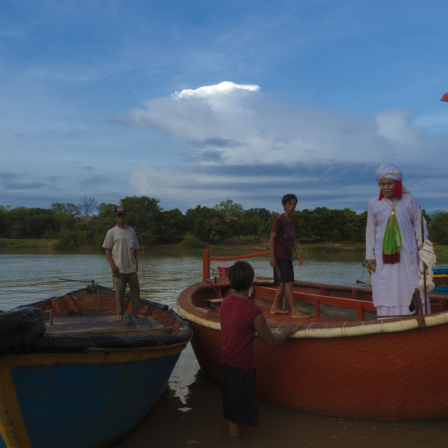 """""""Cham Muslim priest perpares for crossing the river by bamboo boat"""" stock image"""
