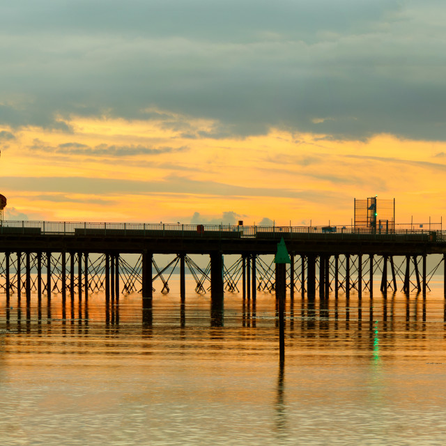 """Pier at sunset"" stock image"