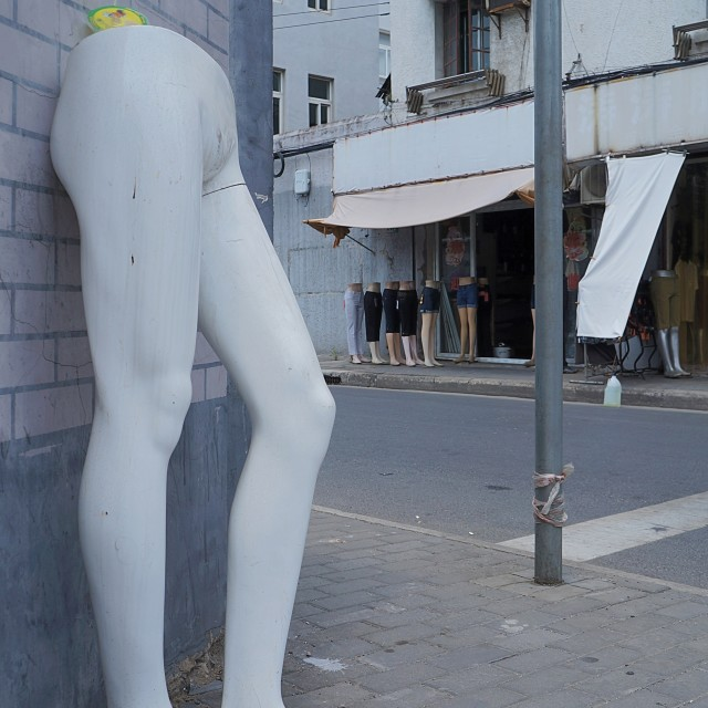 """Mannequin Legs Street Corner"" stock image"