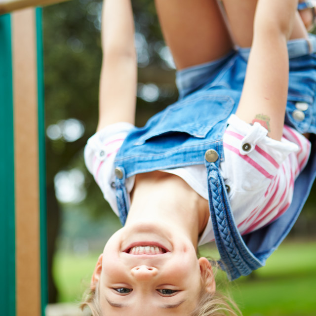 """""""Young Girl On Climbing Frame In Playground"""" stock image"""
