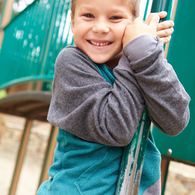 """""""Young Boy On Climbing Frame In Playground"""" stock image"""