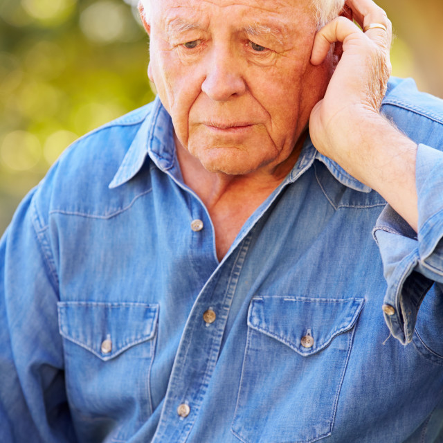 """Depressed Senior Man Sitting Outside"" stock image"