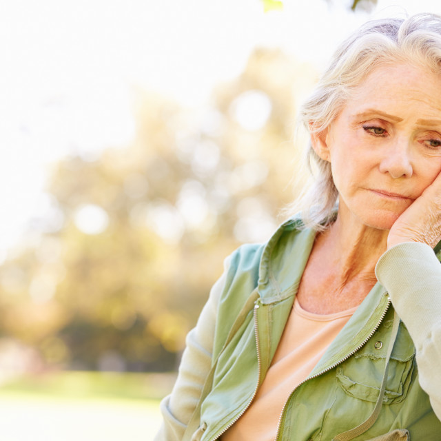 """Depressed Senior Woman Sitting Outside"" stock image"