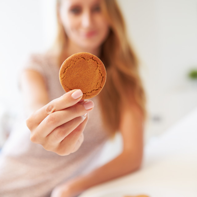 """""""Woman Eats Ginger Biscuit To Stop Nausea Of Morning Sickness"""" stock image"""