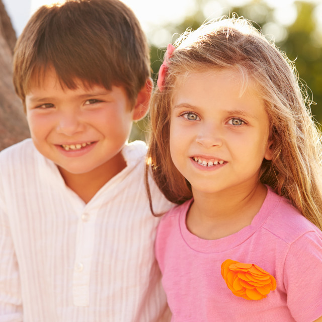 """Portrait Of Boy And Girl In Park Together"" stock image"