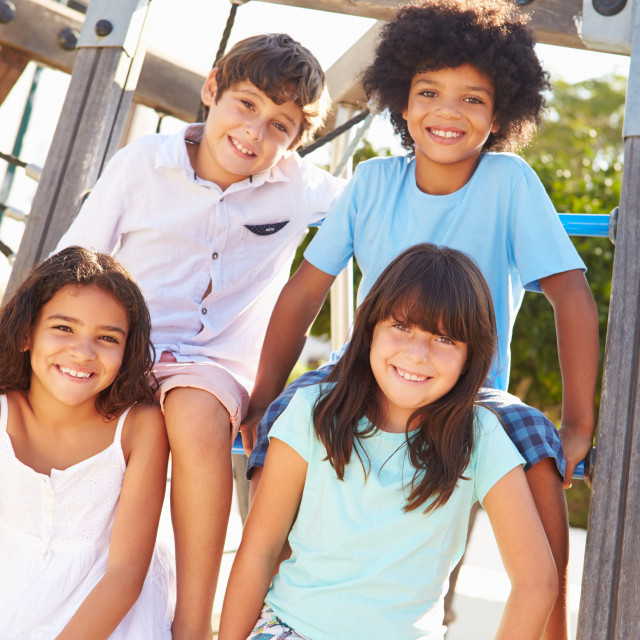 """""""Group Of Children On Playground Climbing Frame"""" stock image"""