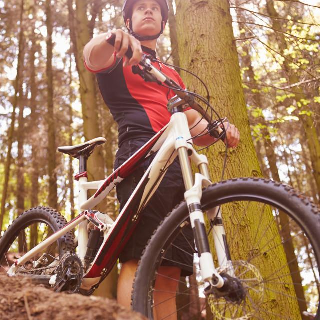 """""""Man Riding Mountain Bike Through Woods"""" stock image"""
