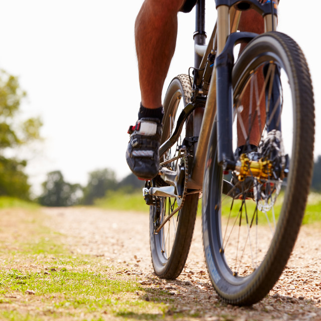 """Close Up Of Man Riding Mountain Bike On Countryside Path"" stock image"