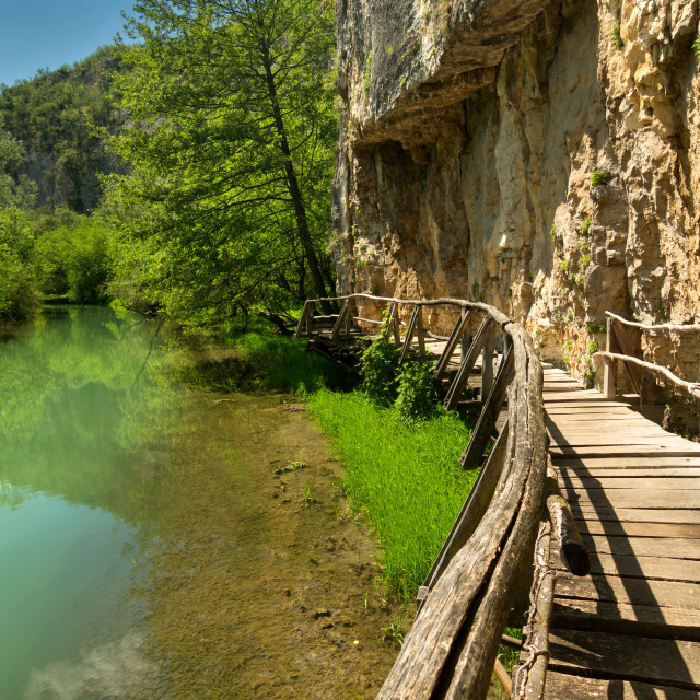 """""""Wooden path along the river"""" stock image"""
