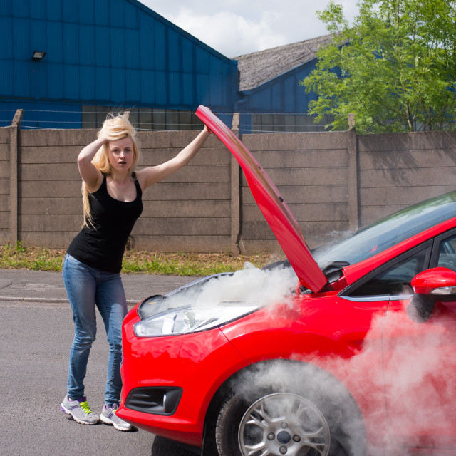"""""""young woman with car on fire"""" stock image"""