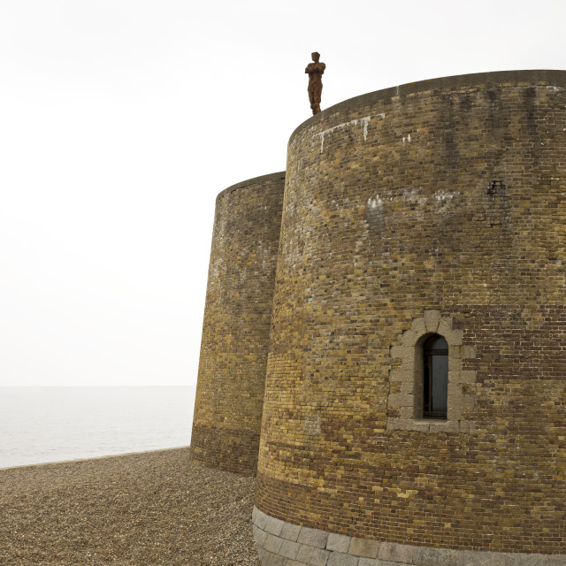 """Gormley on the Martello Tower"" stock image"