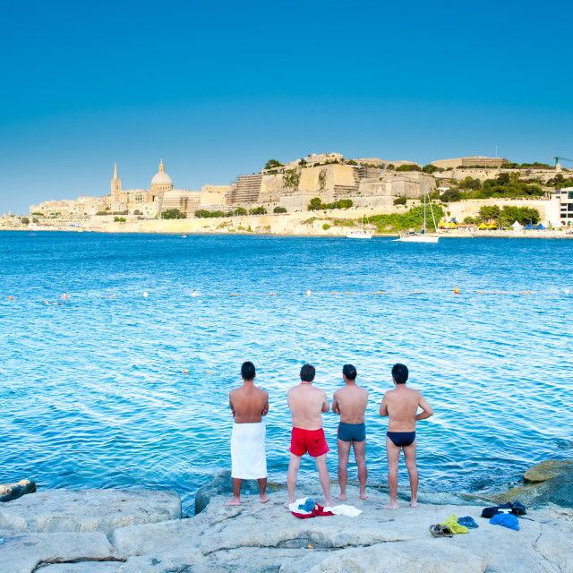 """People looking at the sea bay"" stock image"
