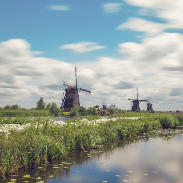 """Windmills by the Lake"" stock image"