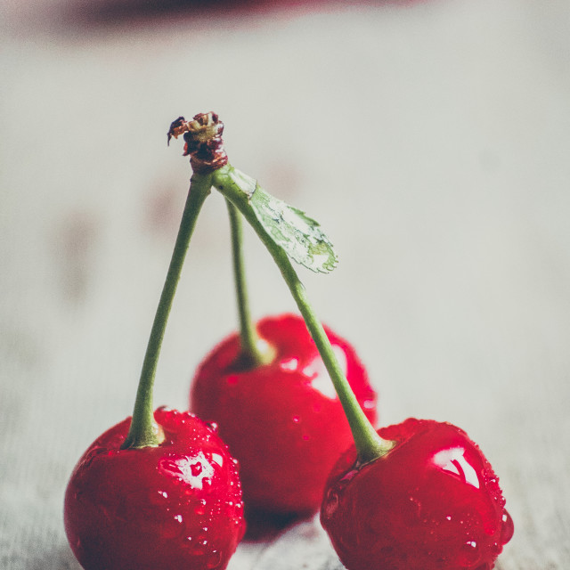 """Cherries on wooden background"" stock image"