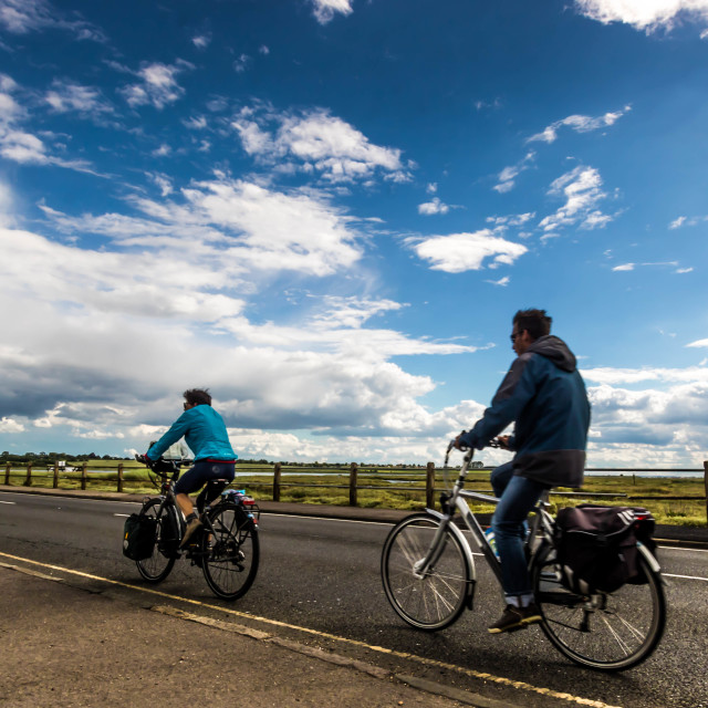 """""""Cycling against the wind"""" stock image"""