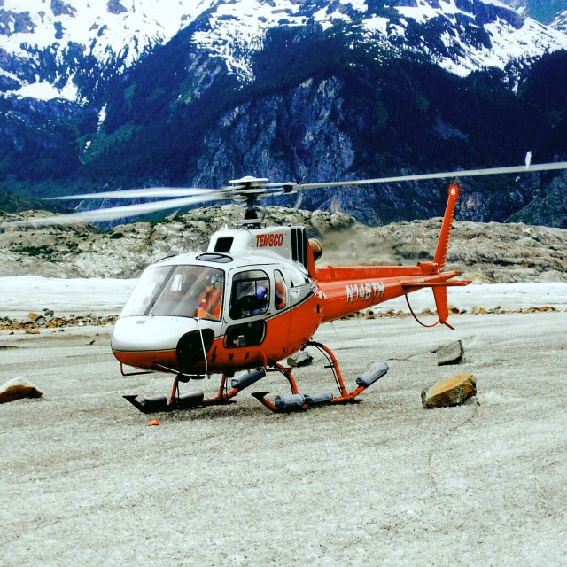 """Helicopter Landing on Glacier"" stock image"