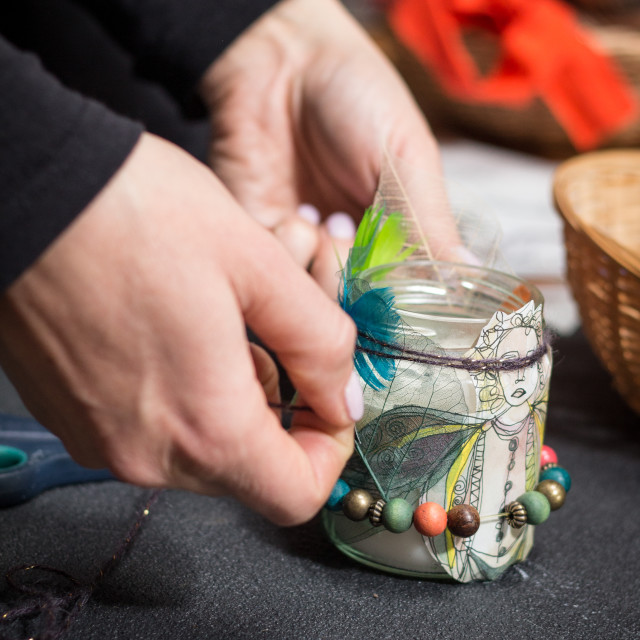 """""""hands decorating candle"""" stock image"""