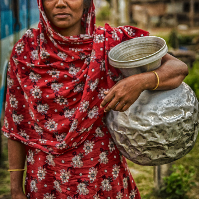 """Village girl fetching water"" stock image"