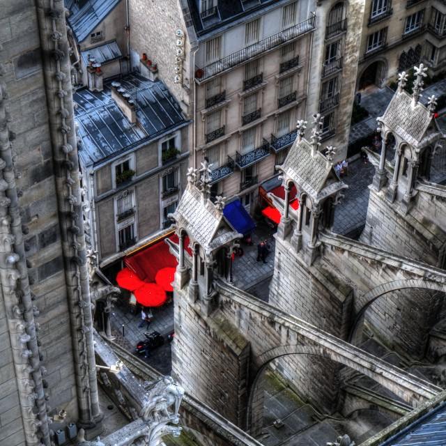 """Paris Cafe Umbrellas from top of Notre Dame"" stock image"