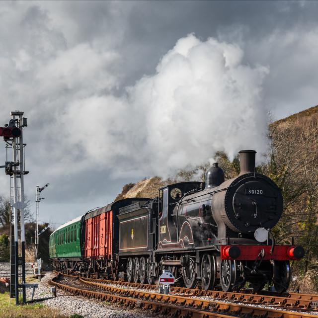 """Heading into Corfe under threatening skies"" stock image"