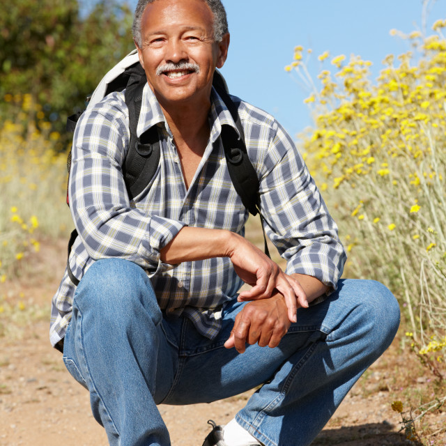 """Senior man on country hike"" stock image"