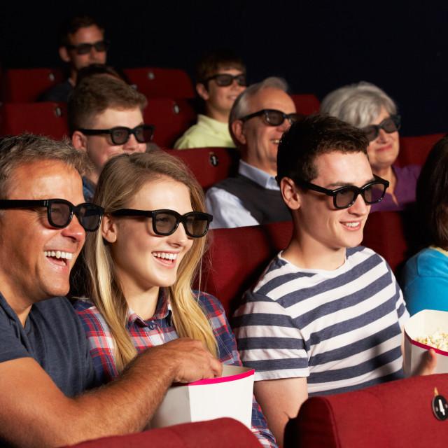 """Teenage Family Watching 3D Film In Cinema"" stock image"