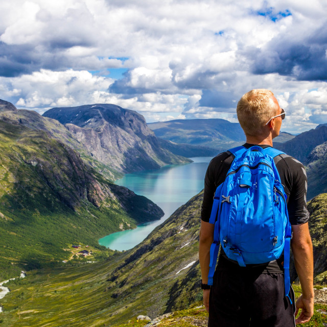 """Mountain landscape and young man"" stock image"