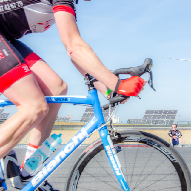 """Cyclist & fan @24hour Race"" stock image"