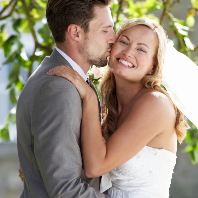 """""""Romantic Bride And Groom Embracing Outdoors"""" stock image"""