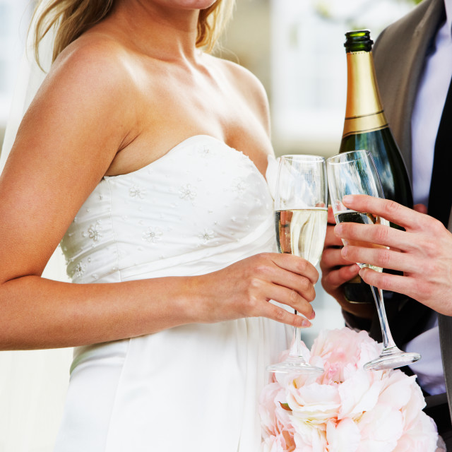 """""""Detail Of Bride And Groom Drinking Champagne At Wedding"""" stock image"""